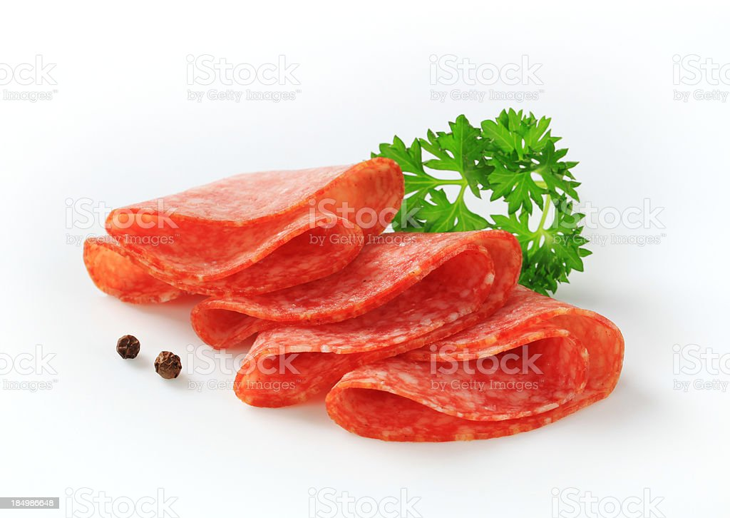 Slices of pepperoni salami royalty-free stock photo