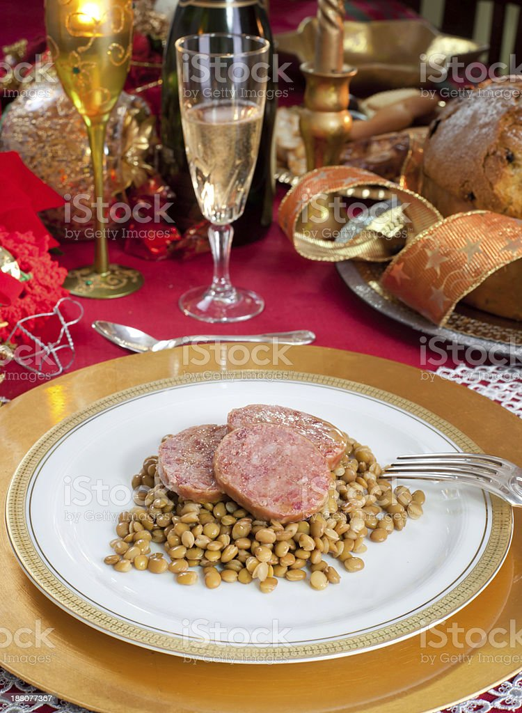 Slices of pig trotter with lentils over christmas table stock photo