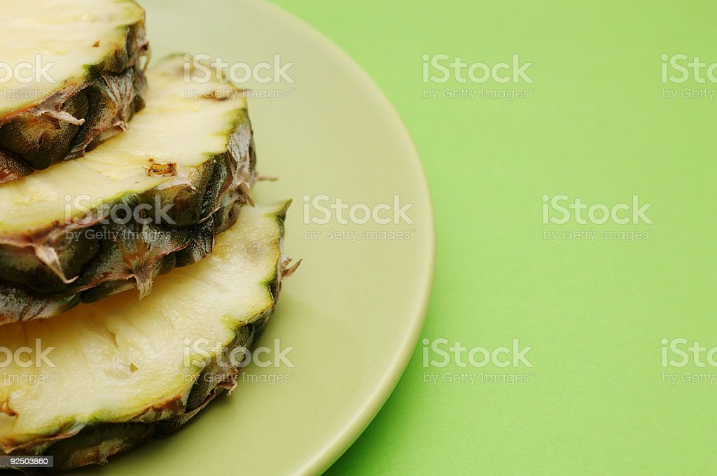 slices of pinapple on green plate royalty-free stock photo