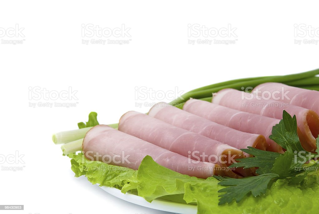 slices of pork and fresh greens royalty-free stock photo
