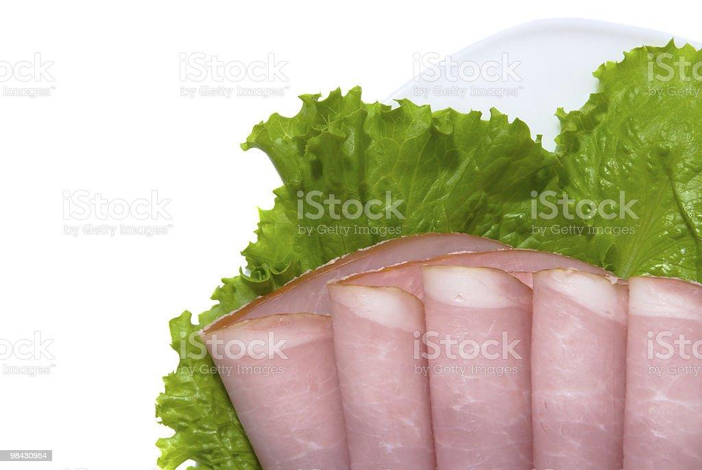Fette di carne di maiale e insalata fresca foto stock royalty-free