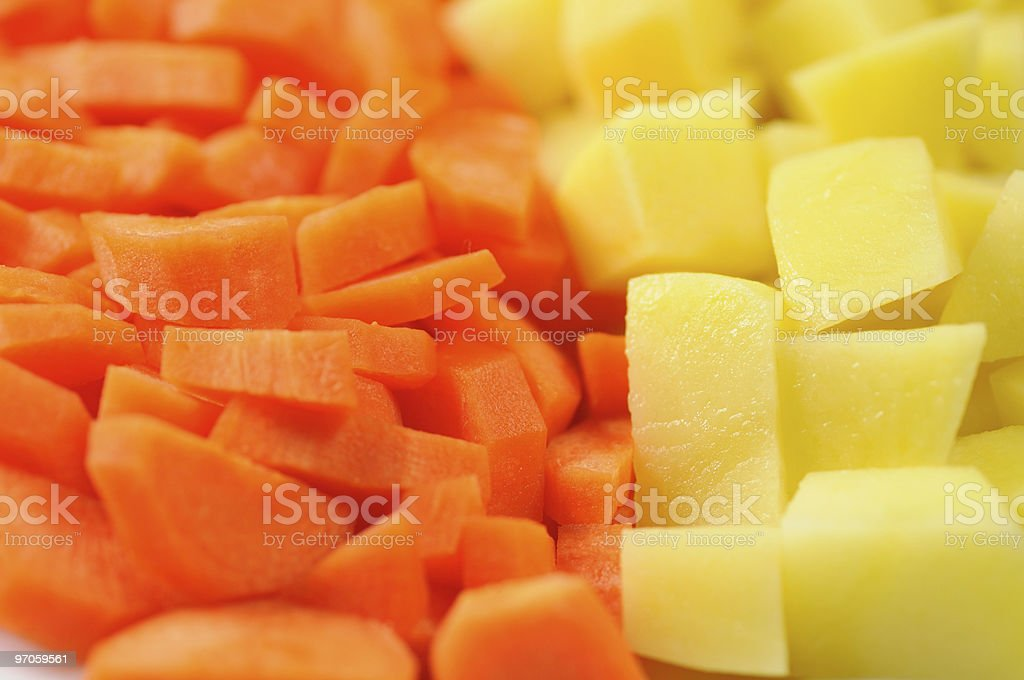 Slices of raw carrots and potatoes royalty-free stock photo