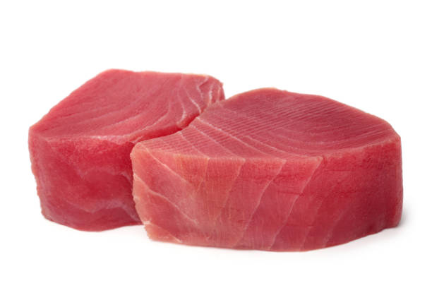 Slices of raw tuna fish meat Slices of raw tuna fish meat on white background tuna animal stock pictures, royalty-free photos & images
