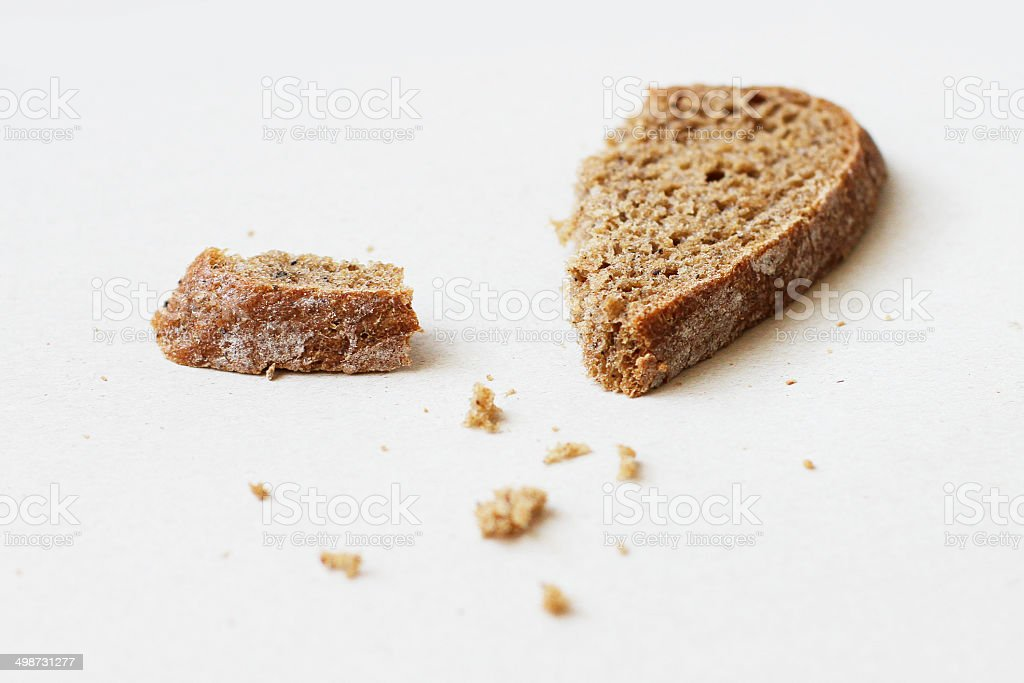 Slices of rye bread and crumbs stock photo
