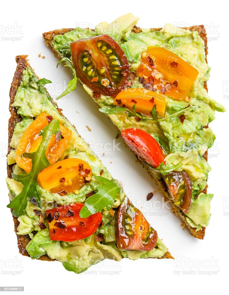 Slices of rye bread with avocado stock photo
