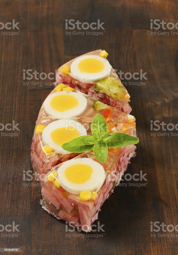 Slices of savory aspic cake royalty-free stock photo