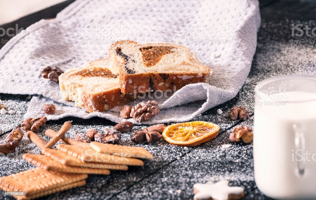 Slices of sponge cake and roasted nuts stock photo