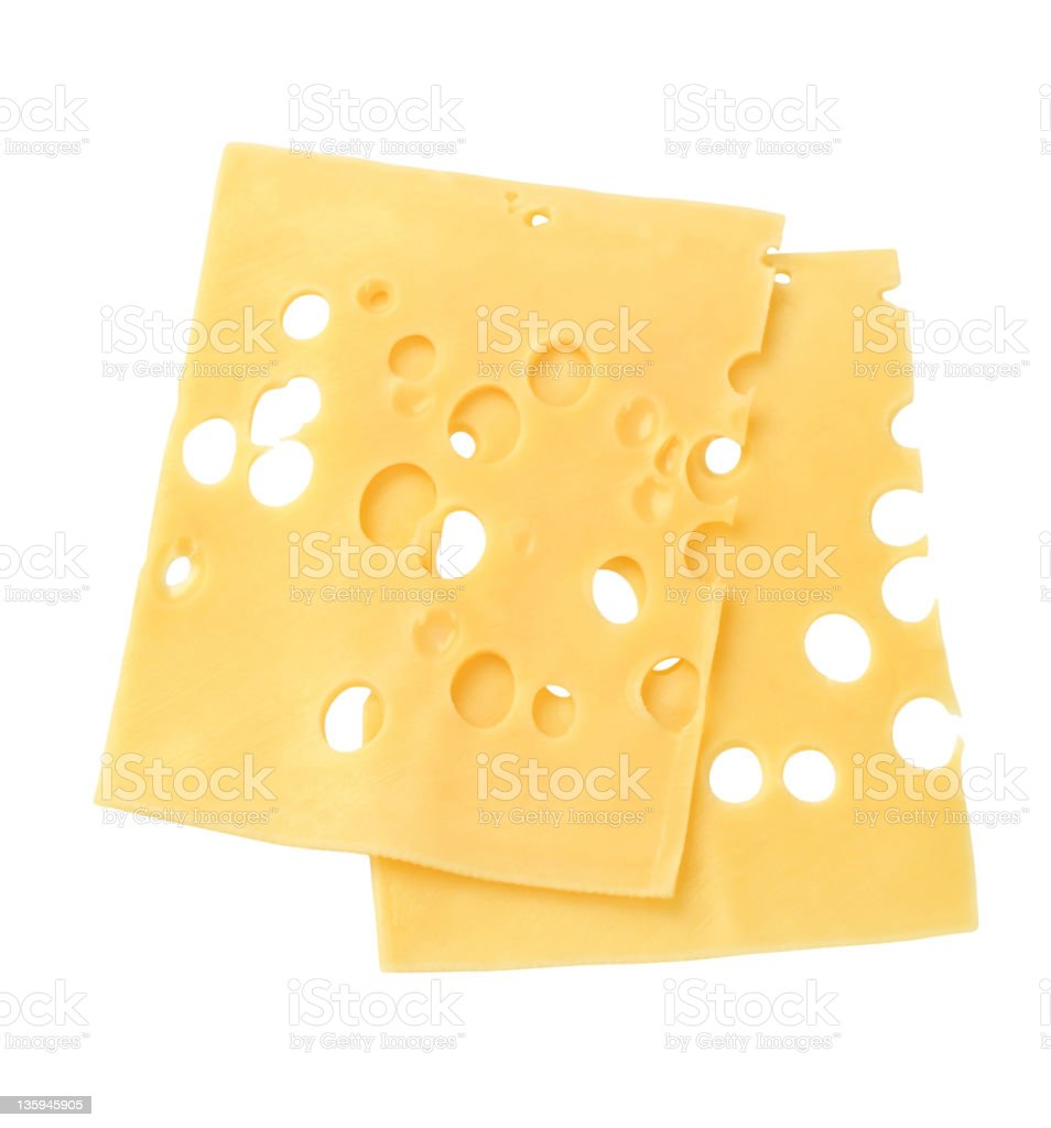 Slices of Swiss cheese with multi holes stock photo