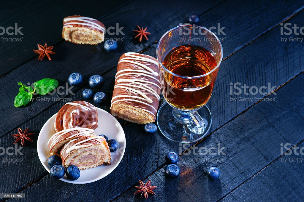 Slices of Swiss roll, blueberry and tea stock photo