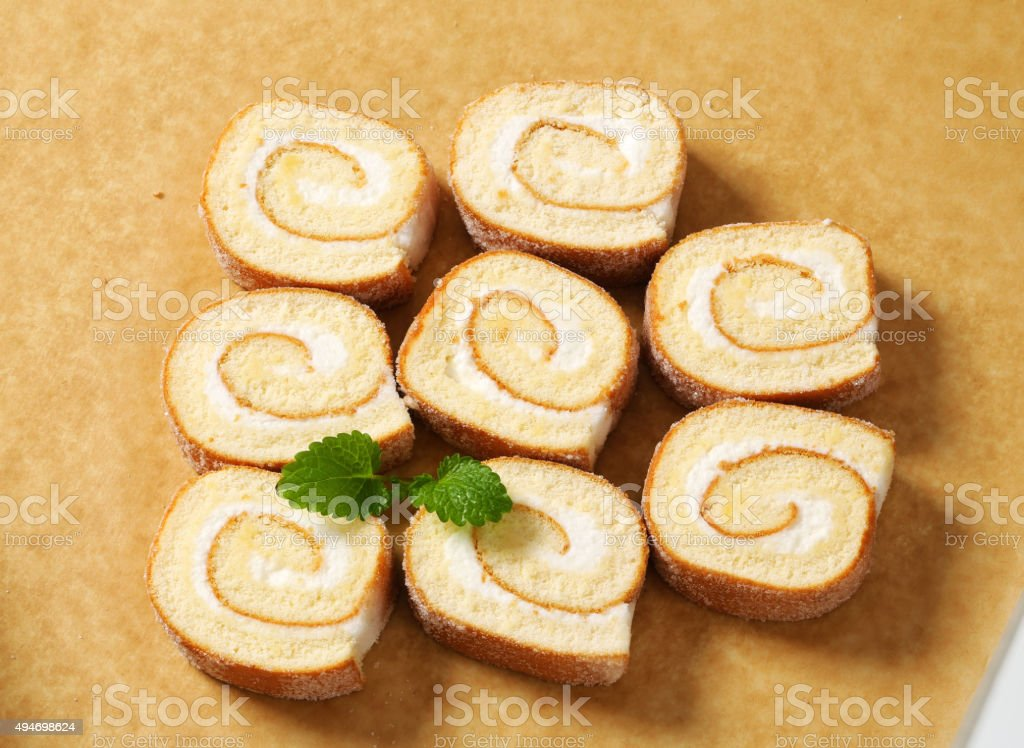 Slices of Swiss roll stock photo