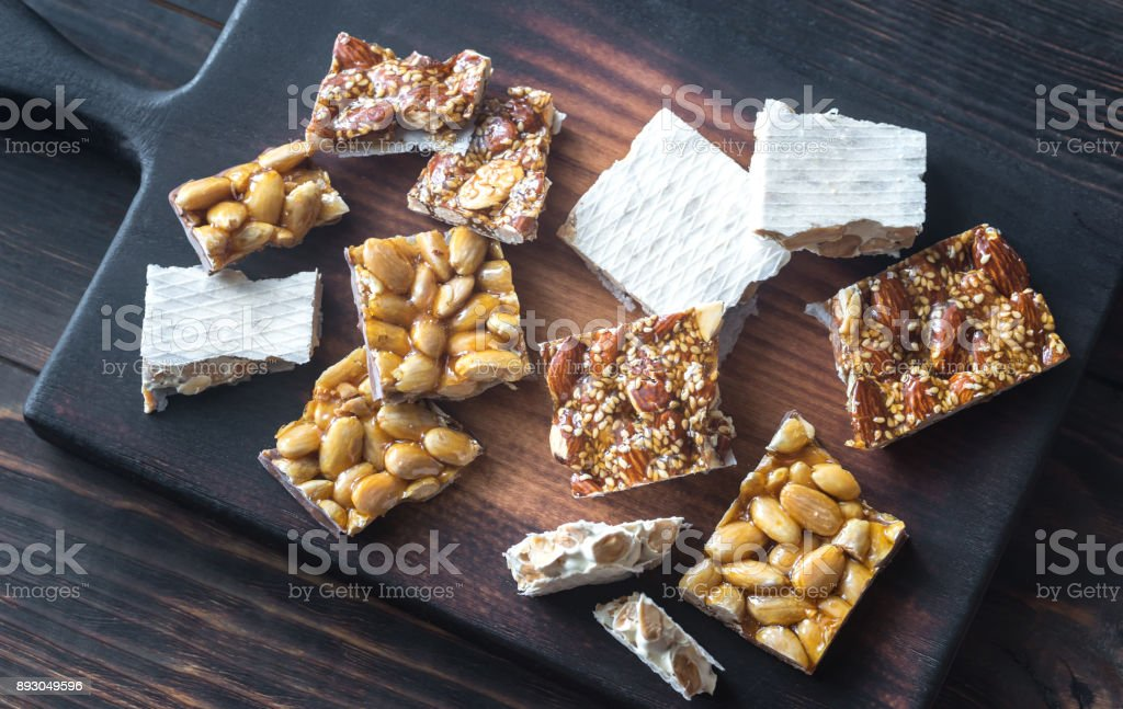 Slices of turron on the wooden board stock photo
