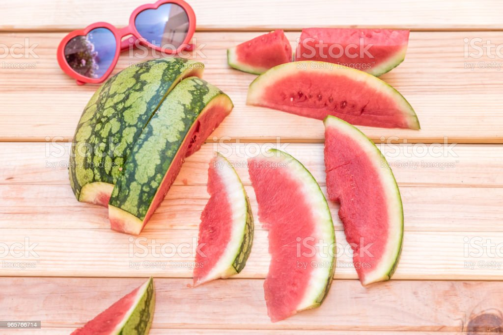 slices of watermelon and red sunglasses with heart shape on wooden background - Royalty-free Berry Stock Photo