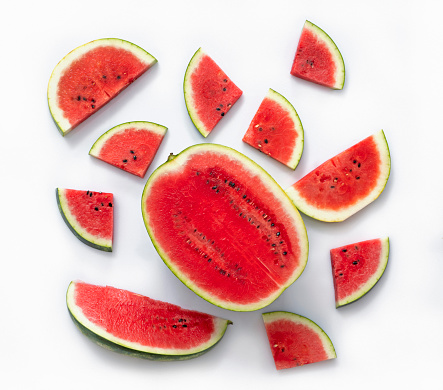 Slices of watermelon isolated on white background, high angle view