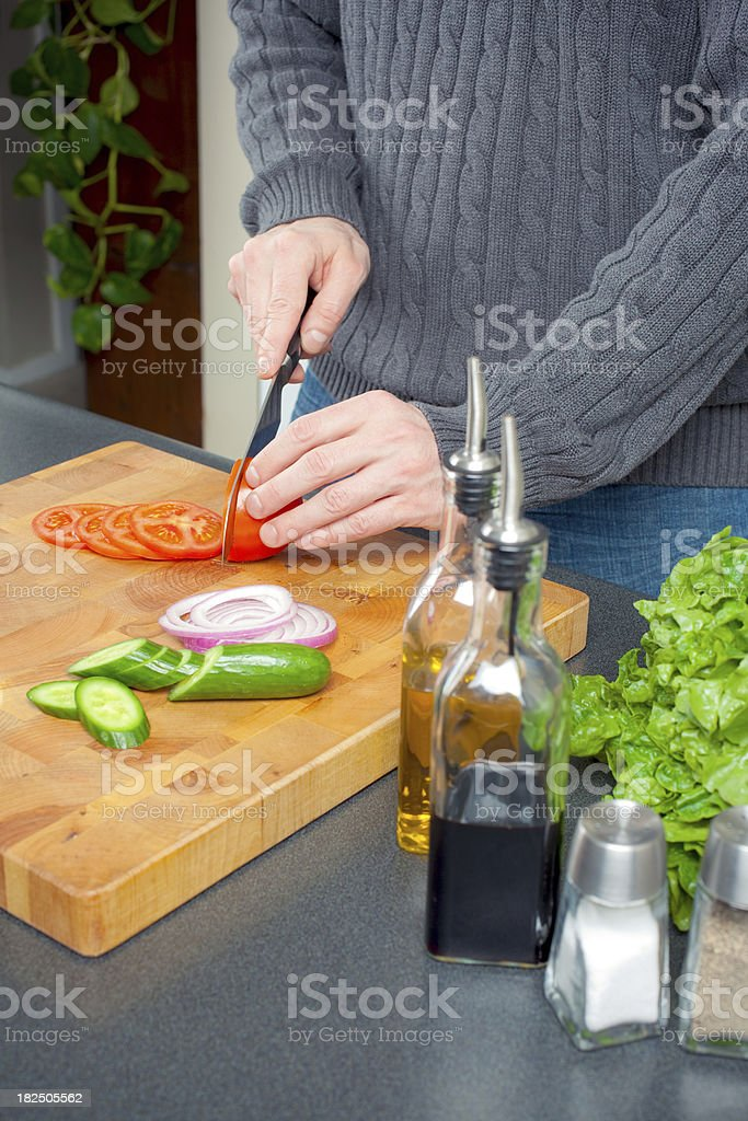 Slicing a Tomato stock photo