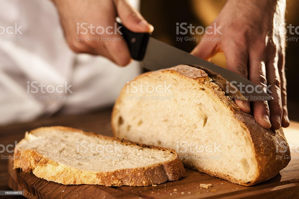 Slicing Bread royalty-free stock photo
