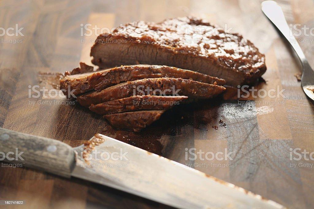 slicing brisket stock photo