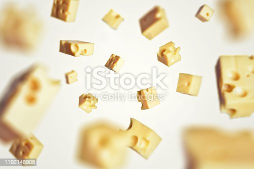Slicing cheese, flying food cheese. Falling pieces of cheese freezelight of quick motion.