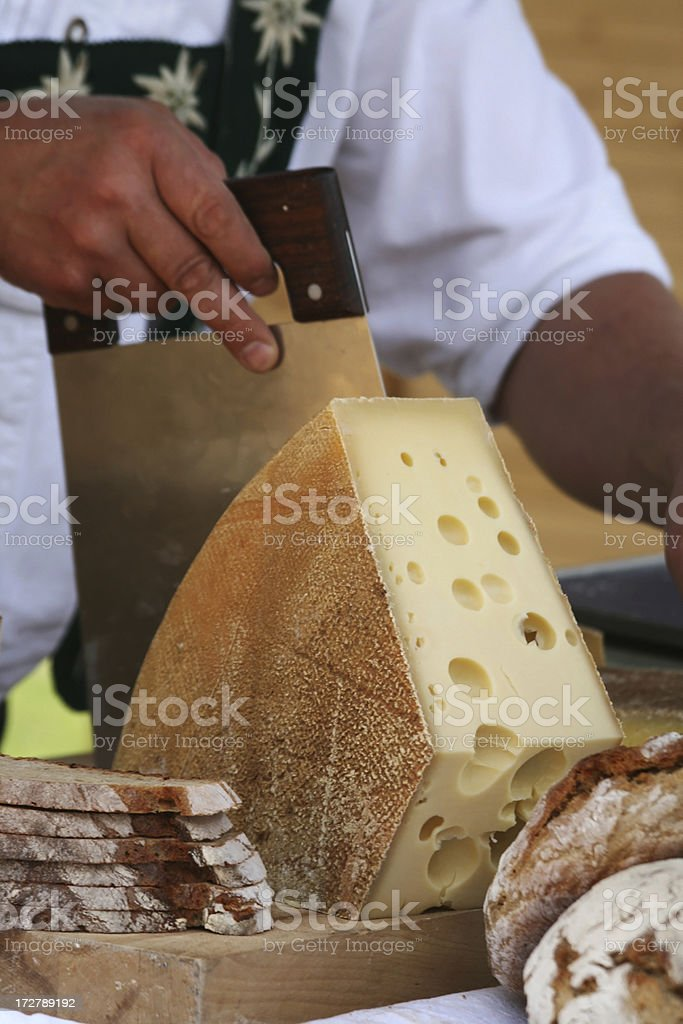 Slicing cheese royalty-free stock photo