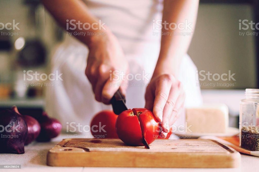 slicing fresh, red tomatoes stock photo