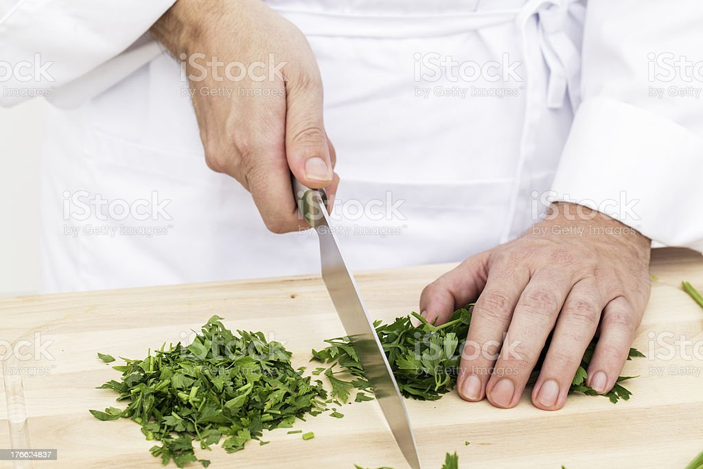 Slicing parsley royalty-free stock photo