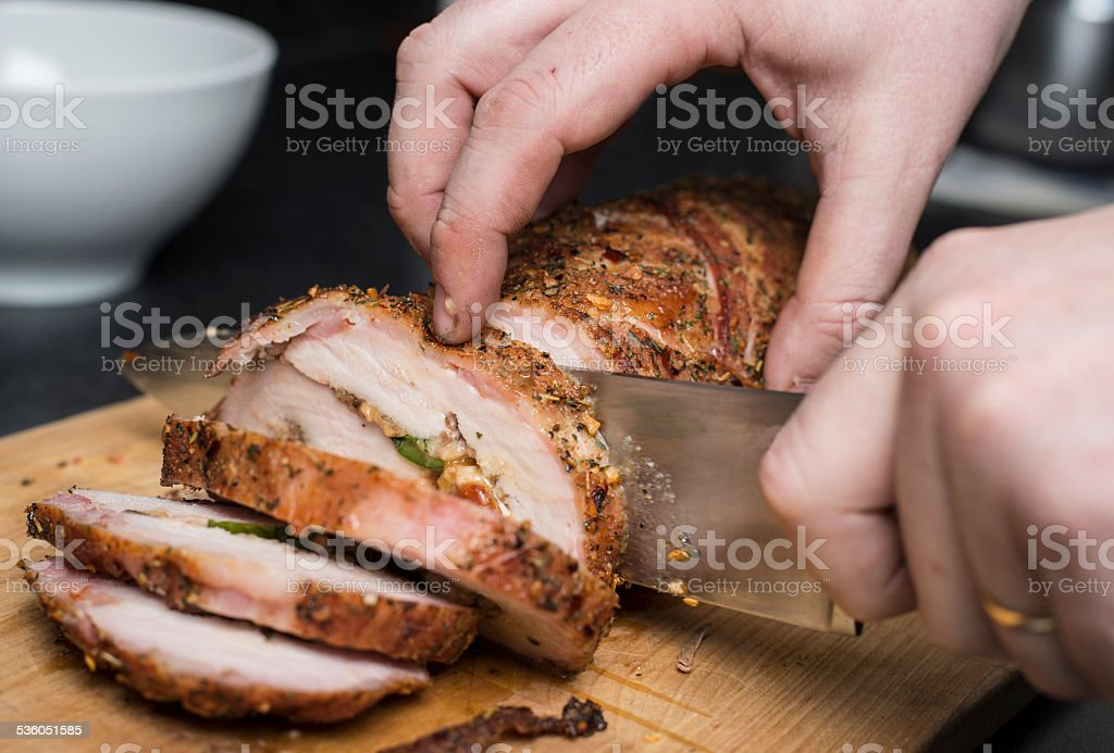 Slicing pork fillet stock photo