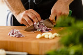 istock Slicing red onion on cutting board, close-up 531415870