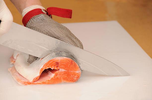Slicing Salmon stock photo