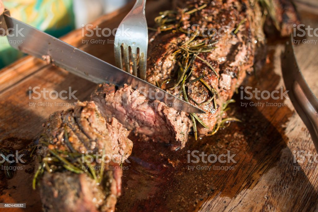 Slicing the meat royalty-free stock photo
