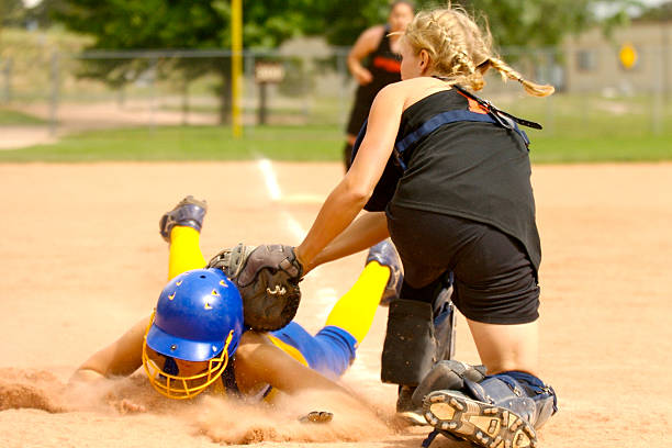 slide at home-plate - softball stock photos and pictures