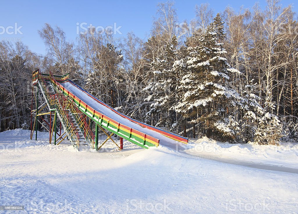 Slide covered with ice in the winter forest. royalty-free stock photo