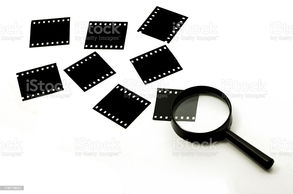 Slide film and magnifier glass stock photo