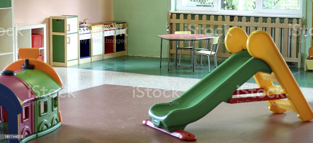 slide in large hall of a nursery stock photo