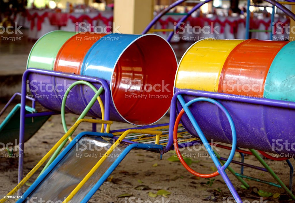 Slide in playground, colorful slider stock photo