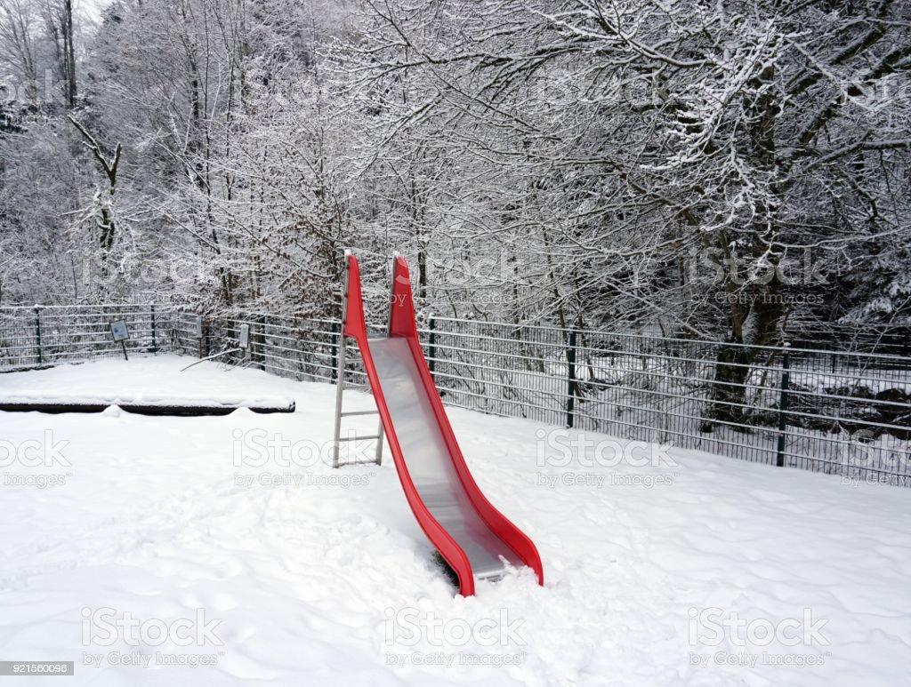 slide in snow stock photo
