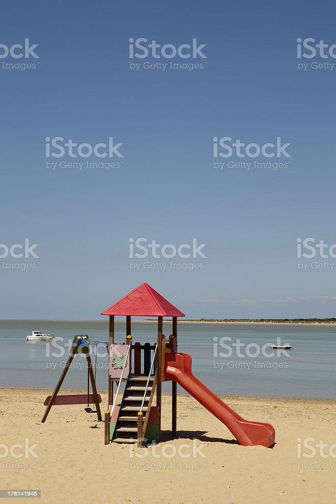 Slide on the beach stock photo