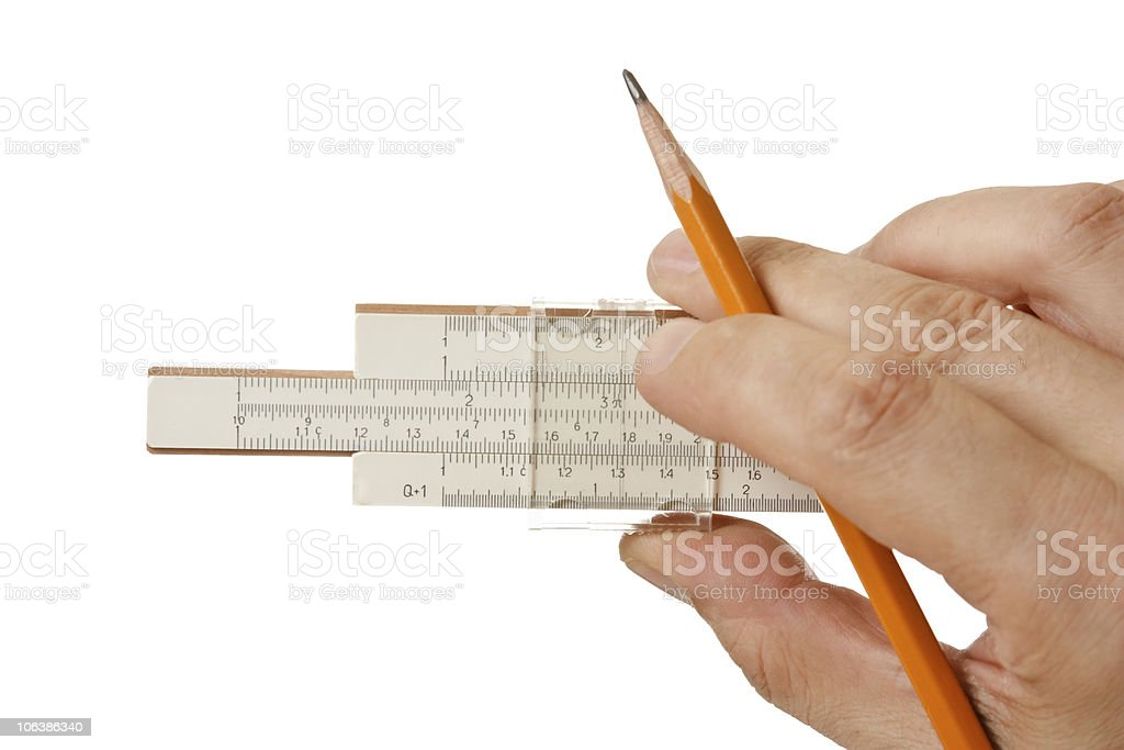 slide rule in hand royalty-free stock photo