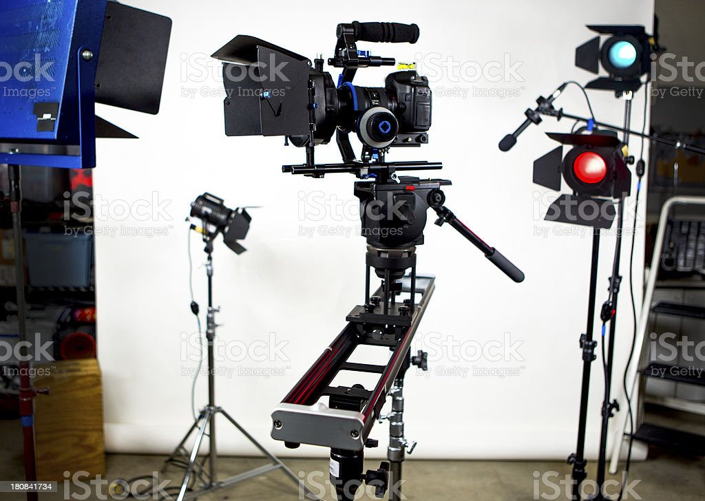 Slider with video camera and studio lights royalty-free stock photo