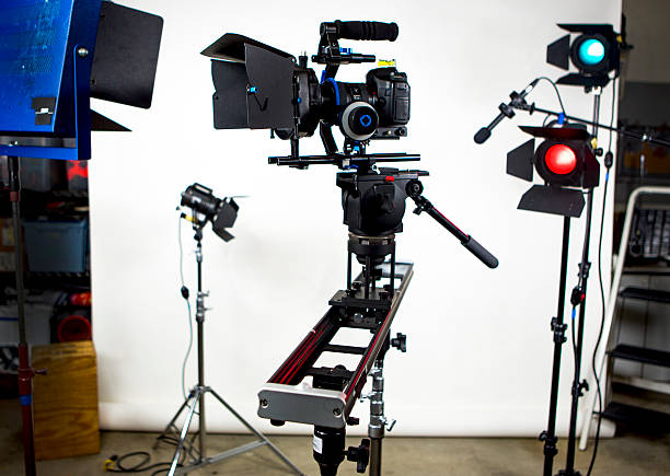 Slider with video camera and studio lights stock photo