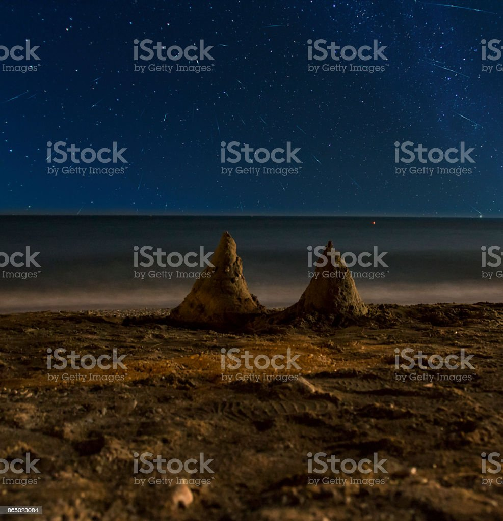 Slides in the sand on the shore of the battlefield under the starry night sky stock photo