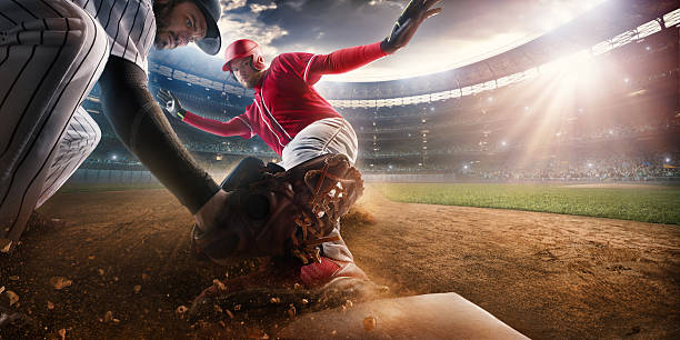 sliding and tagging on third base - sliding stock photos and pictures