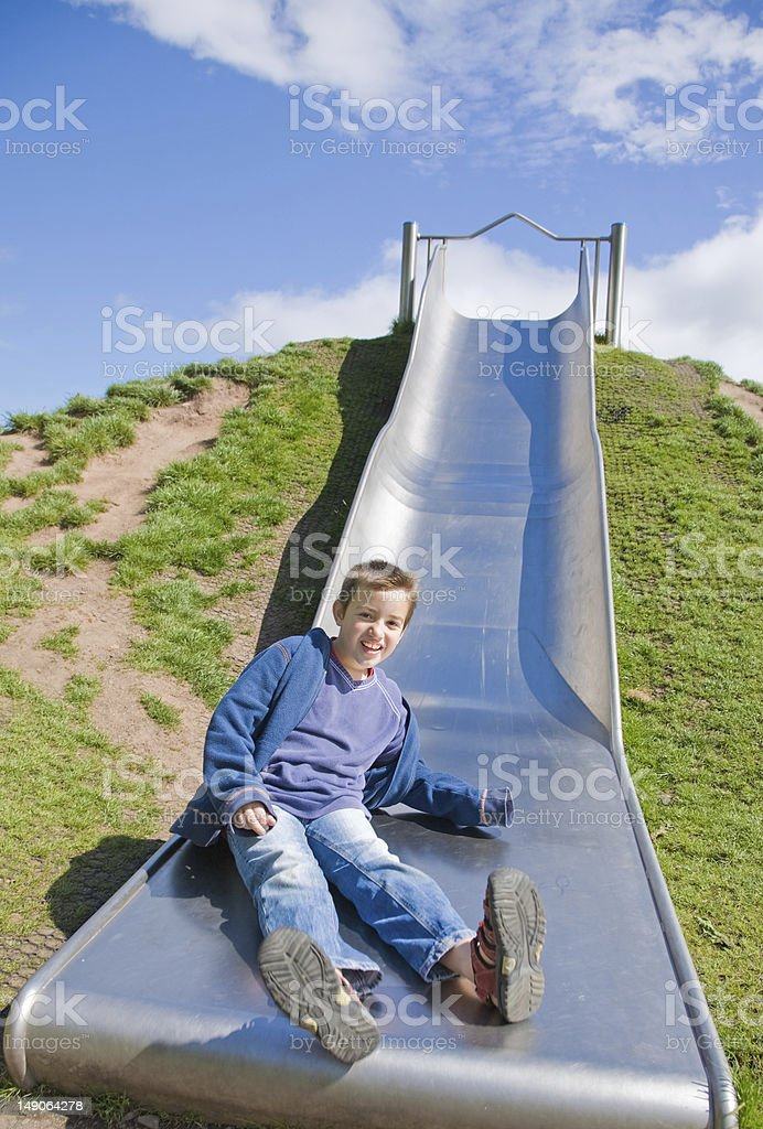 sliding down stock photo