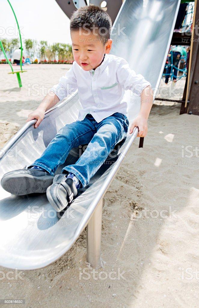 sliding down stock photo