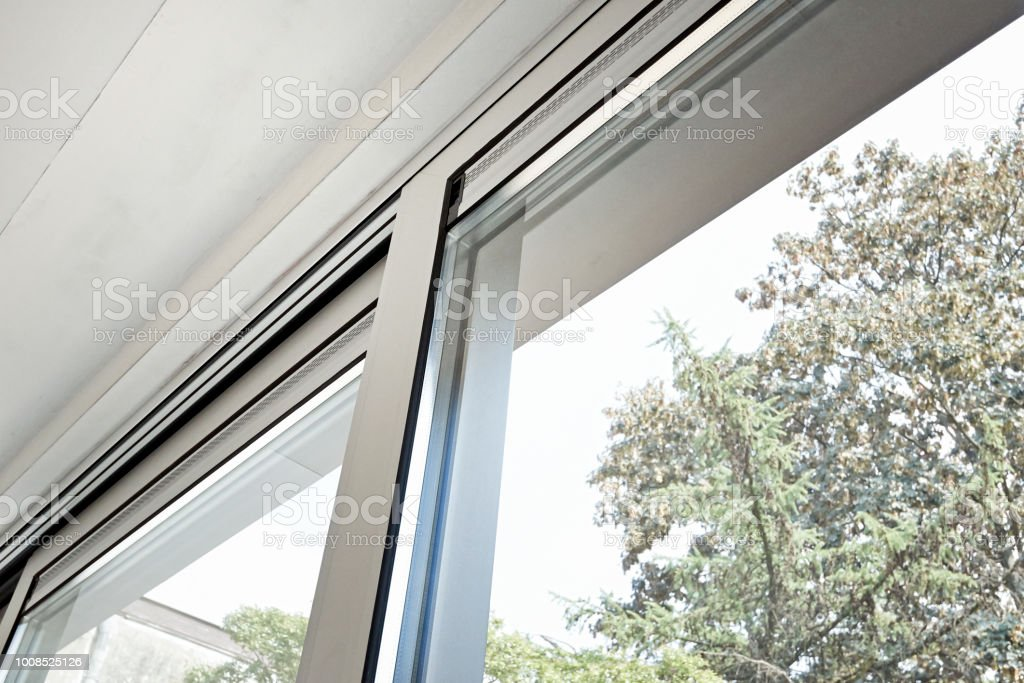 Sliding glass door and his ventilation system stock photo