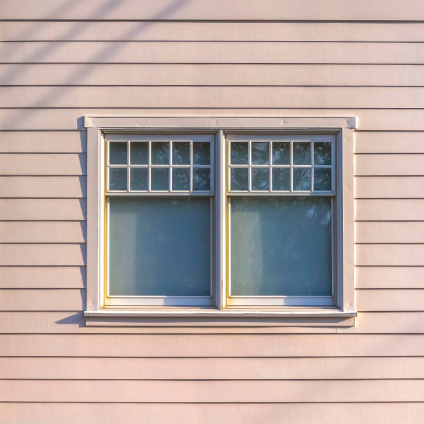 Sliding glass window of a home with white wall stock photo