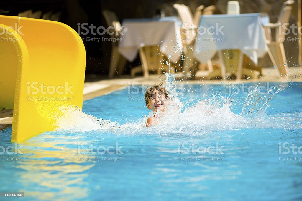 Sliding in pool stock photo