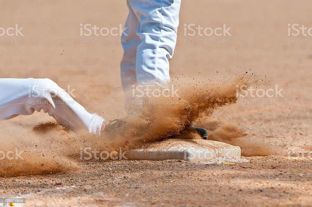 Sliding into Third Base stock photo