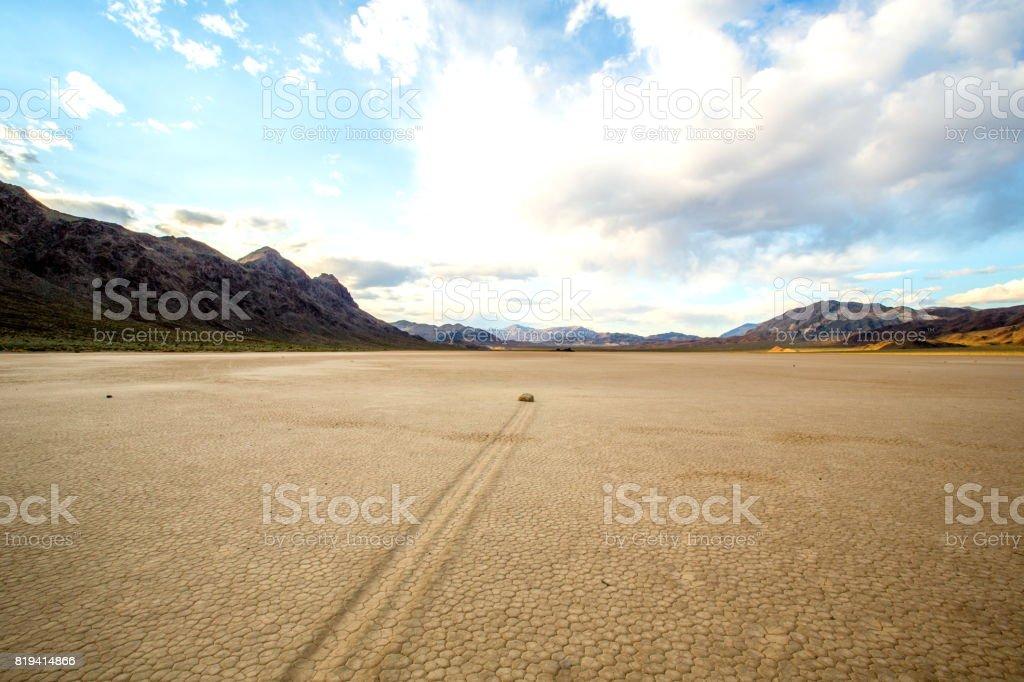 Sliding rock paving a path through the desert, Death valley NP stock photo