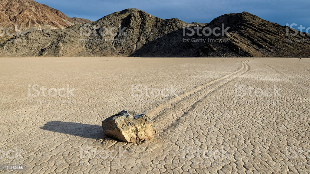 Sliding Stones in Racetrack  on dry lake stock photo