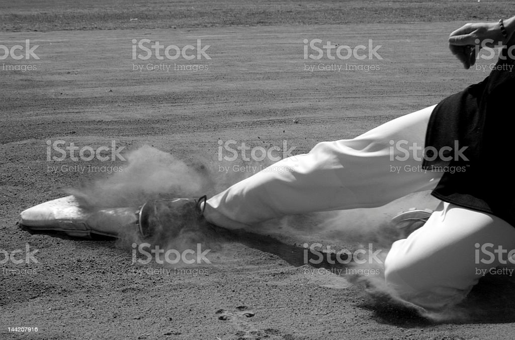 Sliding to home base stock photo