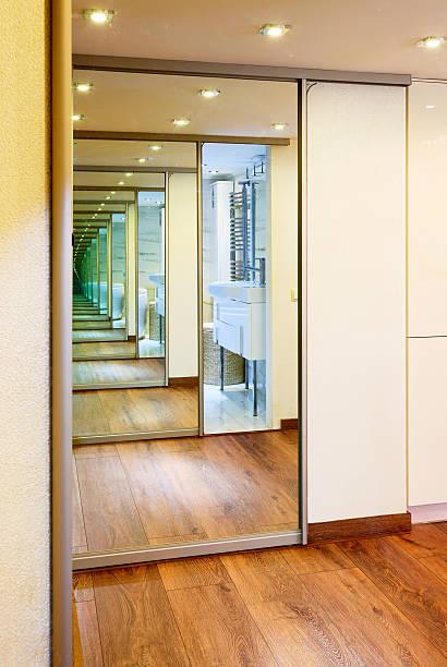 Sliding-door mirror wardrobe in modern hall interior with infini stock photo